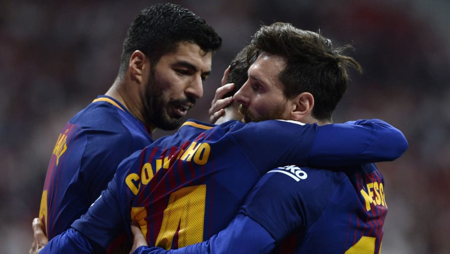 Barcelona's Argentinian forward Lionel Messi (R) celebrates with Barcelona's Brazilian midfielder Philippe Coutinho and Barcelona's Uruguayan forward Luis Suarez after scoring during the Spanish Copa del Rey (King's Cup) final football match Sevilla FC against FC Barcelona at the Wanda Metropolitano stadium in Madrid on April 21, 2018. (Photo by CRISTINA QUICLER / AFP)        (Photo credit should read CRISTINA QUICLER/AFP/Getty Images)