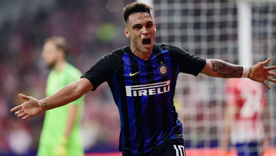 Inter Milan's Argentinian forward Lautaro Martinez celebrates after scoring a goal during the International Champions Cup football match Club Atletico de Madrid vs Inter Milan at the Wanda Metropolitano stadium in Madrid on August 11, 2018. (Photo by JAVIER SORIANO / AFP)        (Photo credit should read JAVIER SORIANO/AFP/Getty Images)