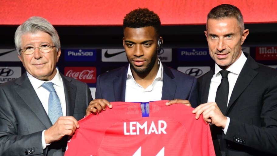 Atletico Madrid's new French midfielder Thomas Lemar (C) poses with his new jersey along with Atletico Madrid president Enrique Cerezo (L) and the club's sports director Andrea Berta during his official presentation at the Wanda Metropolitano Stadium in Madrid on July 30, 2018. (Photo by JAVIER SORIANO / AFP)        (Photo credit should read JAVIER SORIANO/AFP/Getty Images)