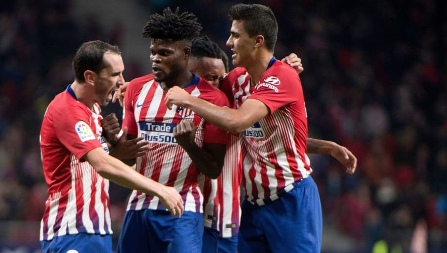 Atletico Madrid's Ghanaian midfielder Thomas (C) celebrates with teammates after scoring a goal during the Spanish league football match between Club Atletico de Madrid and Athletic Club Bilbao at the Wanda Metropolitano stadium in Madrid on November 10, 2018. (Photo by CURTO DE LA TORRE / AFP)        (Photo credit should read CURTO DE LA TORRE/AFP/Getty Images)