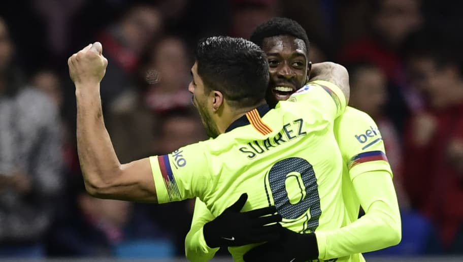 Barcelona's French forward Ousmane Dembele (back) celebrates with Barcelona's Uruguayan forward Luis Suarez after scoring a goal during the Spanish league football match between Club Atletico de Madrid and FC Barcelona at the Wanda Metropolitano stadium in Madrid on November 24, 2018. (Photo by JAVIER SORIANO / AFP)        (Photo credit should read JAVIER SORIANO/AFP/Getty Images)