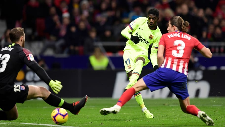 Barcelona's French forward Ousmane Dembele (C) scores a goal during the Spanish league football match between Club Atletico de Madrid and FC Barcelona at the Wanda Metropolitano stadium in Madrid on November 24, 2018. (Photo by JAVIER SORIANO / AFP)        (Photo credit should read JAVIER SORIANO/AFP/Getty Images)