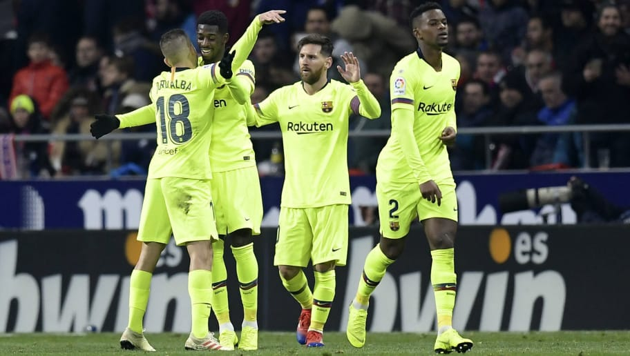 Barcelona's French forward Ousmane Dembele (2ndL) celebrates with teammates after scoring a goal during the Spanish league football match between Club Atletico de Madrid and FC Barcelona at the Wanda Metropolitano stadium in Madrid on November 24, 2018. (Photo by OSCAR DEL POZO / AFP)        (Photo credit should read OSCAR DEL POZO/AFP/Getty Images)