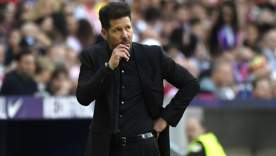 Atletico Madrid's Argentinian coach Diego Simeone reacts during the Spanish league football match between Club Atletico de Madrid and RCD Espanyol at the Wanda Metropolitano stadium in Madrid on May 6, 2018. (Photo by PIERRE-PHILIPPE MARCOU / AFP)        (Photo credit should read PIERRE-PHILIPPE MARCOU/AFP/Getty Images)