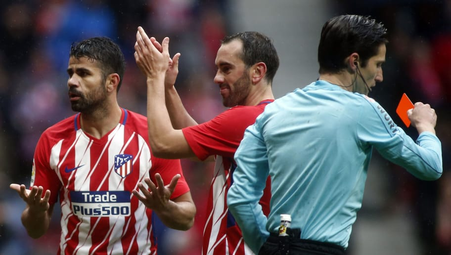 Atletico Madrid's Spanish forward Diego Costa (L) gestures beside Atletico Madrid's Uruguayan defender Diego Godin (C) after being shown a red card for celebrating a goal with supporters during the Spanish league football match Club Atletico de Madrid vs Getafe CF at the Wanda Metropolitano stadium in Madrid on January 6, 2018. / AFP PHOTO / OSCAR DEL POZO        (Photo credit should read OSCAR DEL POZO/AFP/Getty Images)