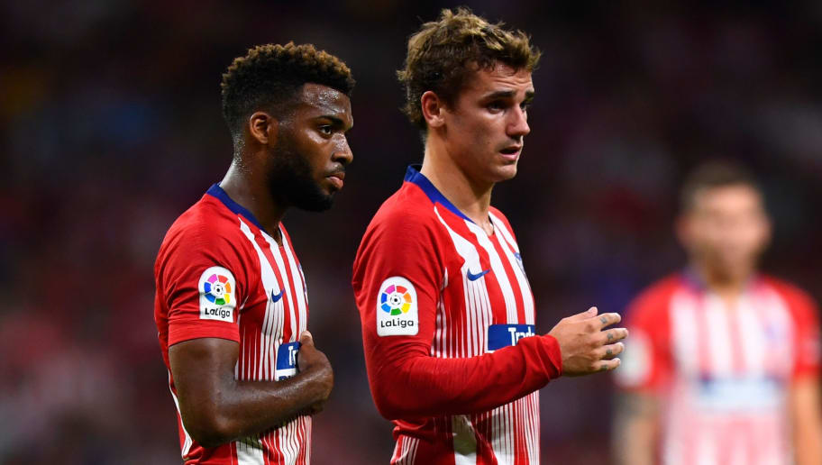 Atletico Madrid's French midfielder Thomas Lemar (L) and Atletico Madrid's French forward Antoine Griezmann look on during the Spanish league football match Club Atletico de Madrid against SD Huesca at the Wanda Metropolitano stadium in Madrid on September 25, 2018. (Photo by GABRIEL BOUYS / AFP)        (Photo credit should read GABRIEL BOUYS/AFP/Getty Images)