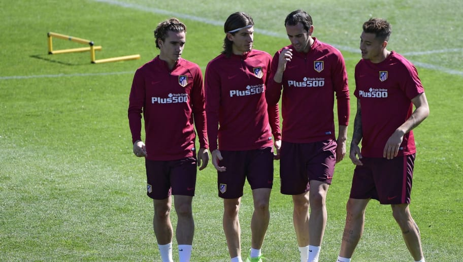 (From L) Atletico Madrid's French forward Antoine Griezmann, Atletico Madrid's Brazilian defender Filipe Luis, Atletico Madrid's Uruguayan defender Diego Godin and Atletico Madrid's Uruguayan defender Jose Maria Gimenez walk on the pitch during a training session at Atletico de Madrid's sport city in Majadahonda, near Madrid on April 7, 2017 on the eve of their Spanish League football match Club Atletico de Madrid vs Real Madrid. / AFP PHOTO / JAVIER SORIANO        (Photo credit should read JAVIER SORIANO/AFP/Getty Images)
