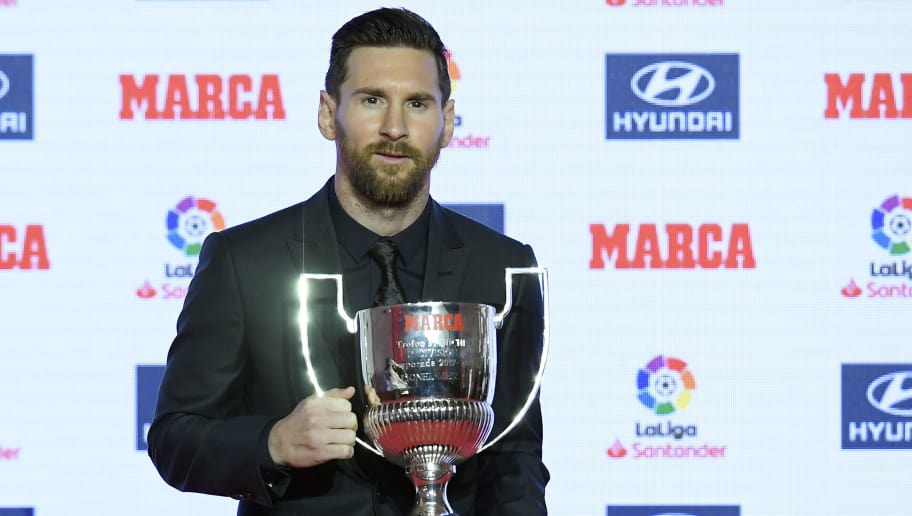Barcelona's Argentinian forward Lionel Messi poses after receiving the Pichichi trophy for the 2017-18 leading goalscorer of the Spanish Liga, during the presentation of the Football Marca Awards in Barcelona on November 12, 2018. (Photo by LLUIS GENE / AFP)        (Photo credit should read LLUIS GENE/AFP/Getty Images)