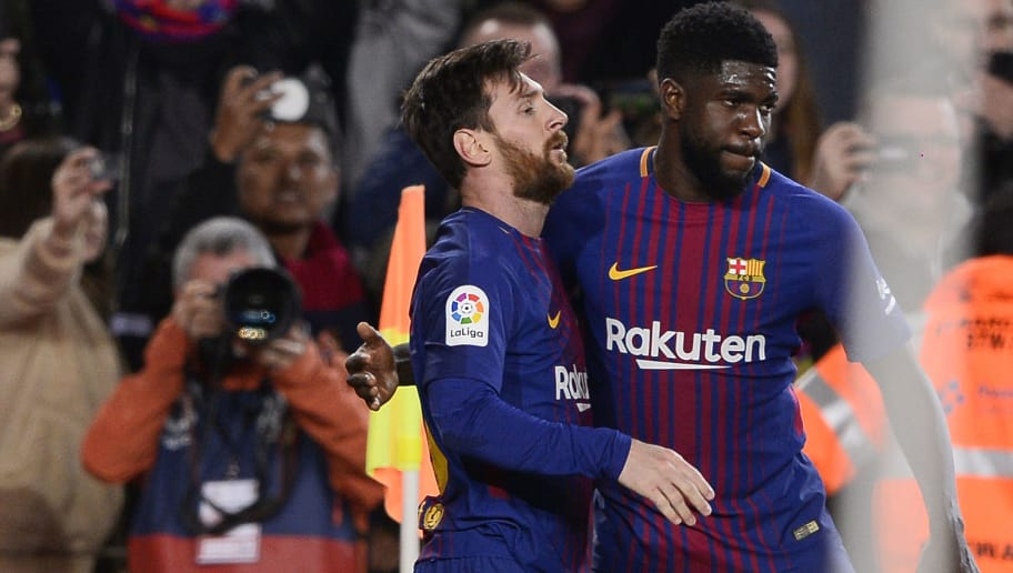 Barcelona's Argentinian forward Lionel Messi (L) celebrates a goal with Barcelona's French defender Samuel Umtiti during the Spanish league football match between FC Barcelona and Deportivo Alaves at the Camp Nou stadium in Barcelona on January 28, 2018. / AFP PHOTO / Josep LAGO        (Photo credit should read JOSEP LAGO/AFP/Getty Images)