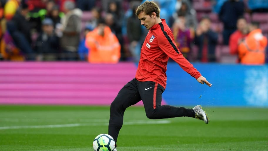 Atletico Madrid's French forward Antoine Griezmann warms up before the Spanish league football match FC Barcelona against Club Atletico de Madrid at the Camp Nou stadium in Barcelona on March 04, 2018. / AFP PHOTO / LLUIS GENE        (Photo credit should read LLUIS GENE/AFP/Getty Images)