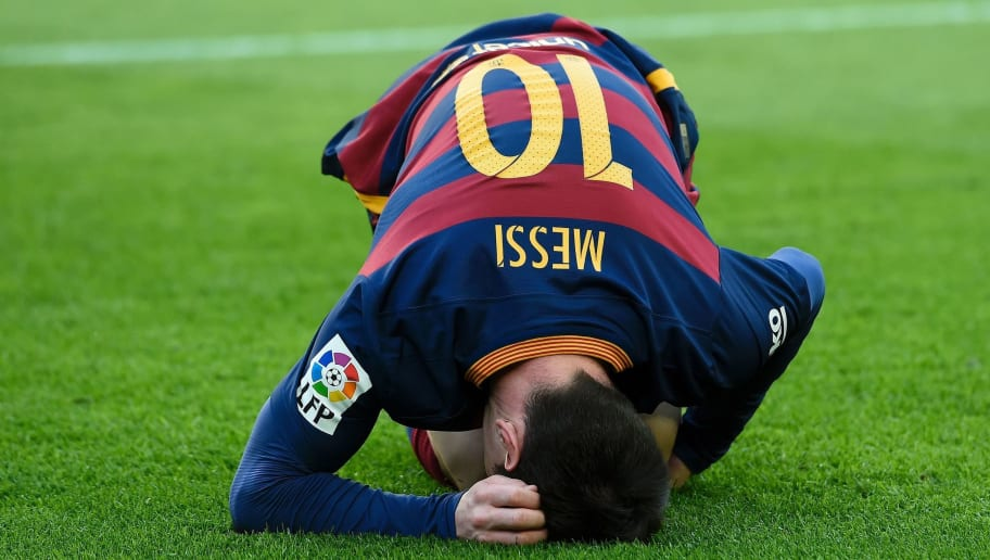 Barcelona's Argentinian forward Lionel Messi reacts to an injury during the Spanish league football match FC Barcelona vs Club Atletico de Madrid at the Camp Nou stadium in Barcelona on January 30, 2016.   AFP PHOTO/ JOSEP LAGO / AFP / JOSEP LAGO        (Photo credit should read JOSEP LAGO/AFP/Getty Images)