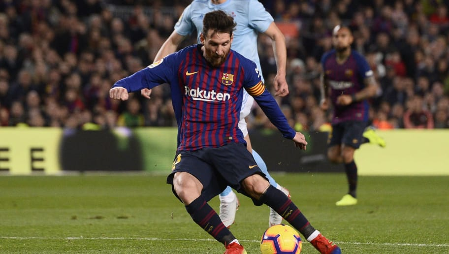 Barcelona's Argentinian forward Lionel Messi shoots to score a goal during the Spanish League football match between FC Barcelona and RC Celta de Vigo at the Camp Nou stadium in Barcelona on Decemeber 22, 2018. (Photo by Josep LAGO / AFP)        (Photo credit should read JOSEP LAGO/AFP/Getty Images)