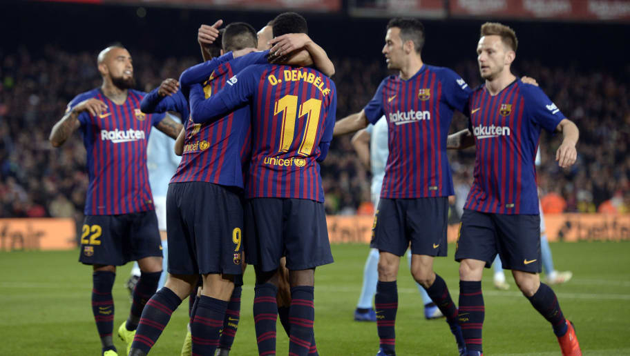 Barcelona's French forward Ousmane Dembele celebrates scoring the opening goal with teammates during the Spanish League football match between FC Barcelona and RC Celta de Vigo at the Camp Nou stadium in Barcelona on Decemeber 22, 2018. (Photo by Josep LAGO / AFP)        (Photo credit should read JOSEP LAGO/AFP/Getty Images)