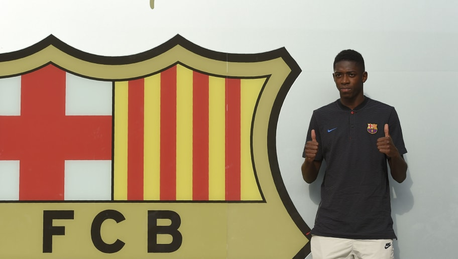 Barcelona's new player French Ousmane Dembele poses outside the Camp Nou stadium in Barcelona, prior to signing his new contract with the Catalan club, on August 27, 2017. French starlet Ousmane Dembele agreed a five-year deal with Barcelona worth 105 million euros ($125 million) plus add-ons. Dembele, 20, moves from Borussia Dortmund, where he has been suspended since he boycotted training on August 10 in protest after the German club rejected Barca's first bid.  / AFP PHOTO / LLUIS GENE        (Photo credit should read LLUIS GENE/AFP/Getty Images)