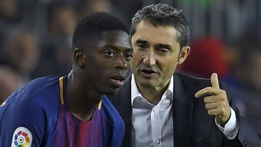 Barcelona's coach Ernesto Valverde (R) talks to Barcelona's French forward Ousmane Dembele during the Spanish Liga football match Barcelona vs Espanyol at the Camp Nou stadium in Barcelona on September 9, 2017. / AFP PHOTO / LLUIS GENE        (Photo credit should read LLUIS GENE/AFP/Getty Images)