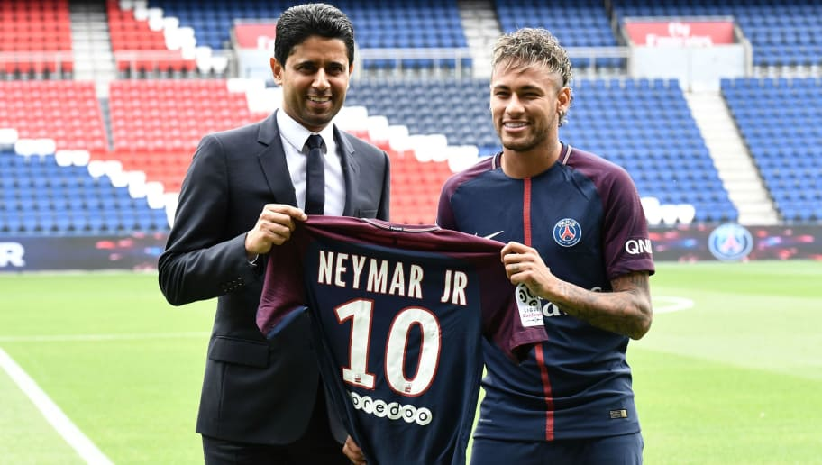 Brazilian superstar Neymar (R) poses with his jersey next to Paris Saint Germain's (PSG) Qatari president Nasser Al-Khelaifi during his official presentation at the Parc des Princes stadium on August 4, 2017 in Paris after agreeing a five-year contract following his world record 222 million euro ($260 million) transfer from Barcelona to PSG. Paris Saint-Germain have signed Brazilian forward Neymar from Barcelona for a world-record transfer fee of 222 million euros (around $264 million), more than doubling the previous record. Neymar said he came to Paris Saint-Germain for a 'bigger challenge' in his first public comments since arriving in the French capital. / AFP PHOTO / PHILIPPE LOPEZ        (Photo credit should read PHILIPPE LOPEZ/AFP/Getty Images)