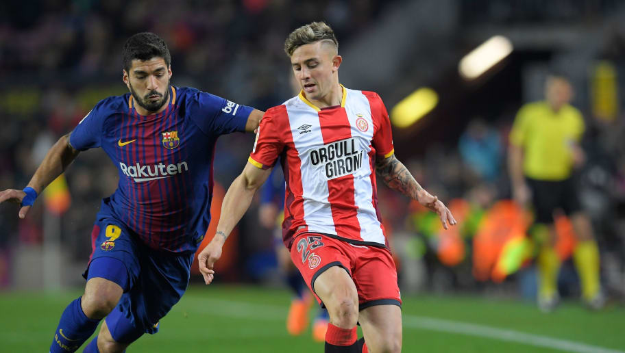 Girona's Spanish defender Pablo Maffeo (R) vies with Barcelona's Uruguayan forward Luis Suarez (L) during the Spanish league football match between FC Barcelona and Girona FC at the Camp Nou stadium in Barcelona on February 24, 2018. / AFP PHOTO / LLUIS GENE        (Photo credit should read LLUIS GENE/AFP/Getty Images)