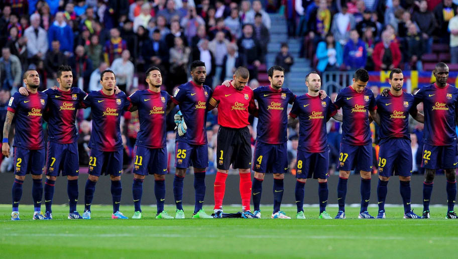 (L-R) Barcelona's Brazilian defender Dani Alves, Barcelona's forward David Villa, Barcelona's Brazilian defender Adriano, Barcelona's midfielder Thiago Alcantara, Barcelona's Cameroonian midfielder Alex Song, Barcelona's goalkeeper Victor Valdes, Barcelona's midfielder Cesc Fabregas, Barcelona's midfielder Andres Iniesta, Barcelona's forward Cristian Tello, Barcelona's defender Martin Montoya, Barcelona's French defender Eric Abidal hold a minute's silence in memory of those killed in the Boston Marathon bombings before the Spanish league football match FC Barcelona vs Levante UD at the Camp Nou stadium in Barcelona on April 20, 2013. AFP PHOTO / JOSEP LAGO / AFP / Josep Lago        (Photo credit should read JOSEP LAGO/AFP/Getty Images)