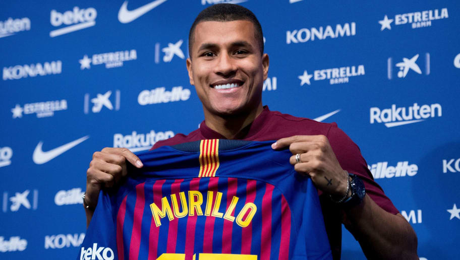 Barcelona's new player Colombian defender Jeison Murillo displays his jersey during his official presentation at the Camp Nou stadium in Barcelona on December 27, 2018. (Photo by Josep LAGO / AFP)        (Photo credit should read JOSEP LAGO/AFP/Getty Images)