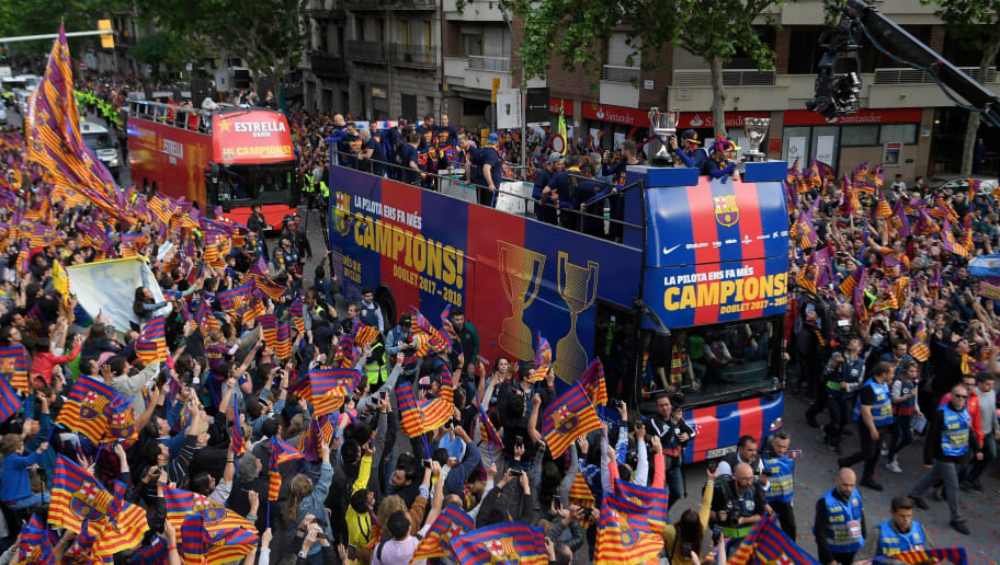 Barcelona players and staff parade with open-top buses to celebrate their 25th La Liga title in Barcelona on April 30, 2018. - Barcelona won their 25th La Liga title after a 4-2 win against Deportivo La Coruna. (Photo by LLUIS GENE / AFP)        (Photo credit should read LLUIS GENE/AFP/Getty Images)