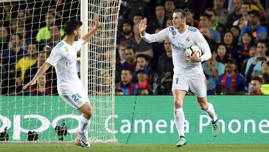 Real Madrid's Welsh forward Gareth Bale (R) celebrates with Real Madrid's Spanish midfielder Marco Asensio after scoring a goal during the Spanish league football match between FC Barcelona and Real Madrid CF at the Camp Nou stadium in Barcelona on May 6, 2018. (Photo by LLUIS GENE / AFP)        (Photo credit should read LLUIS GENE/AFP/Getty Images)