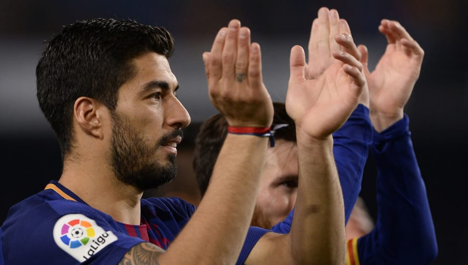 Barcelona's Uruguayan forward Luis Suarez (L) and Barcelona's Argentinian forward Lionel Messi celebrate at the end of the Spanish league football match between FC Barcelona and Real Madrid CF at the Camp Nou stadium in Barcelona on May 6, 2018. (Photo by Josep LAGO / AFP)        (Photo credit should read JOSEP LAGO/AFP/Getty Images)