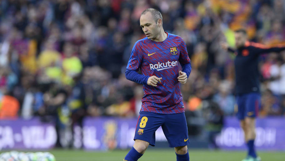 Barcelona's Spanish midfielder Andres Iniesta warms up before the Spanish league football match between FC Barcelona and Real Madrid CF at the Camp Nou stadium in Barcelona on May 6, 2018. (Photo by Josep LAGO / AFP)        (Photo credit should read JOSEP LAGO/AFP/Getty Images)