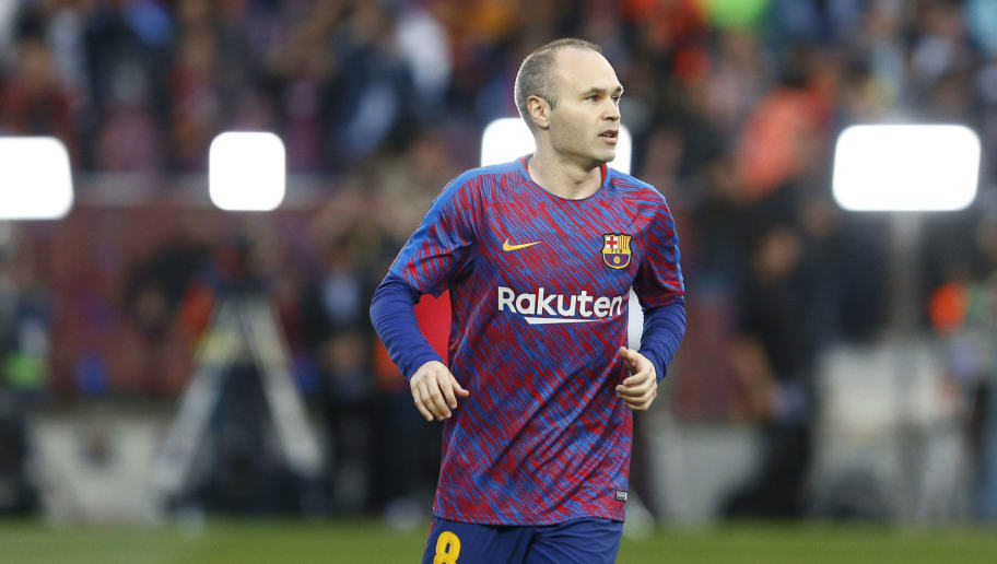 Barcelona's Spanish midfielder Andres Iniesta warms up before the Spanish league football match between FC Barcelona and Real Madrid CF at the Camp Nou stadium in Barcelona on May 6, 2018. (Photo by Pau Barrena / AFP)        (Photo credit should read PAU BARRENA/AFP/Getty Images)