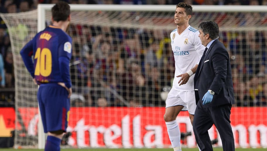 Real Madrid's Portuguese forward Cristiano Ronaldo (L) walks with his team's doctor after resulting injured during the Spanish league football match between FC Barcelona and Real Madrid CF at the Camp Nou stadium in Barcelona on May 6, 2018. (Photo by Josep LAGO / AFP)        (Photo credit should read JOSEP LAGO/AFP/Getty Images)