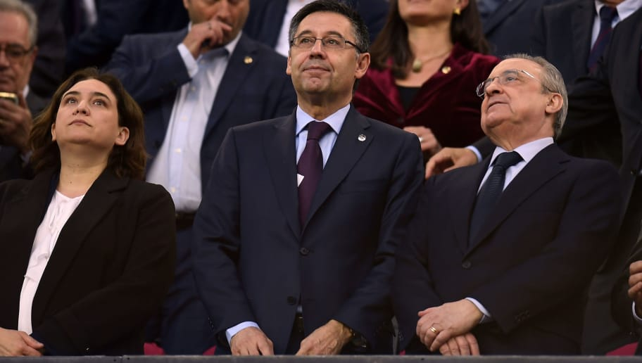 Mayor of Barcelona Ada Colau (L), president of FC Barcelona Josep Maria Bartomeu (C) and president of Real Madrid Florentino Perez attend the  Spanish league football match between FC Barcelona and Real Madrid CF at the Camp Nou stadium in Barcelona on May 6, 2018. (Photo by LLUIS GENE / AFP)        (Photo credit should read LLUIS GENE/AFP/Getty Images)