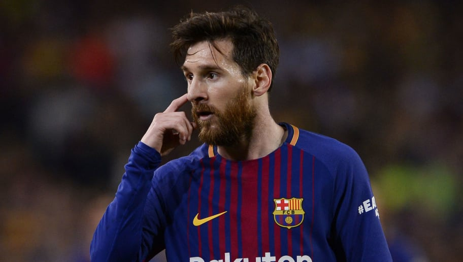 Barcelona's Argentinian forward Lionel Messi gestures during the Spanish league football match between FC Barcelona and Real Madrid CF at the Camp Nou stadium in Barcelona on May 6, 2018. (Photo by Josep LAGO / AFP)        (Photo credit should read JOSEP LAGO/AFP/Getty Images)