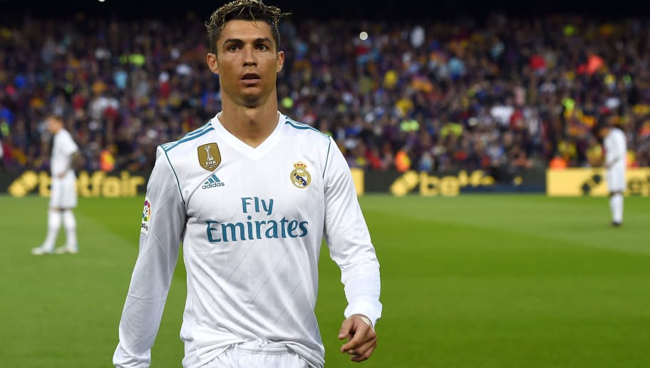 Real Madrid's Portuguese forward Cristiano Ronaldo walks on the pitch during the Spanish league football match between FC Barcelona and Real Madrid CF at the Camp Nou stadium in Barcelona on May 6, 2018. (Photo by Josep LAGO / AFP)        (Photo credit should read JOSEP LAGO/AFP/Getty Images)