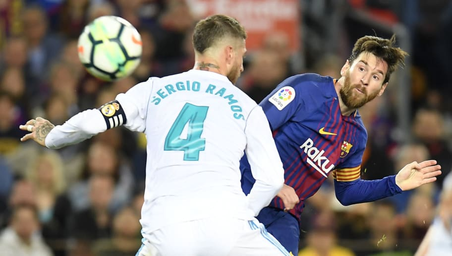 Barcelona's Argentinian forward Lionel Messi (R) challenges Real Madrid's Spanish defender Sergio Ramos during the Spanish league football match between FC Barcelona and Real Madrid CF at the Camp Nou stadium in Barcelona on May 6, 2018. (Photo by LLUIS GENE / AFP)        (Photo credit should read LLUIS GENE/AFP/Getty Images)