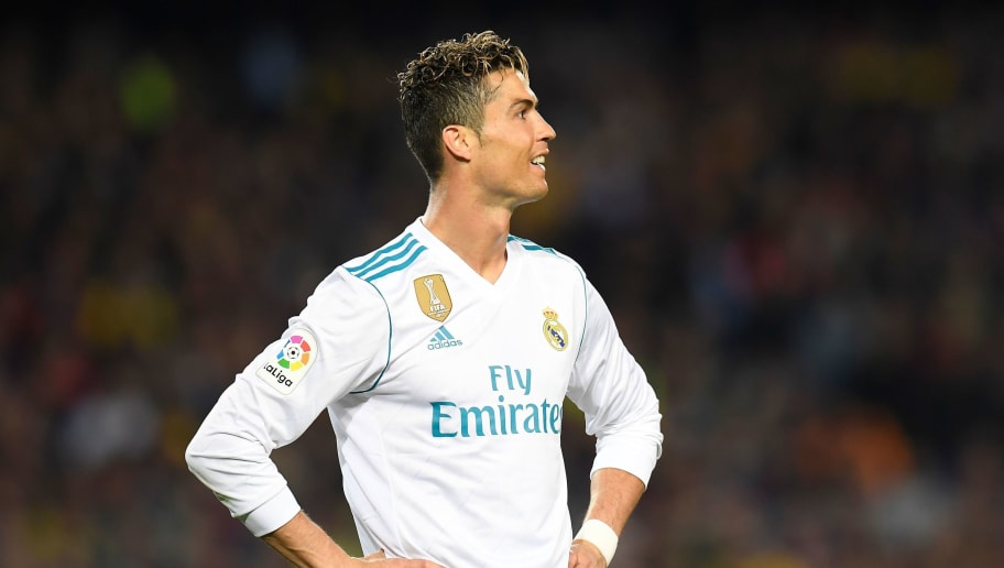 Real Madrid's Portuguese forward Cristiano Ronaldo reacts after missing a goal opportunity during the Spanish league football match between FC Barcelona and Real Madrid CF at the Camp Nou stadium in Barcelona on May 6, 2018. (Photo by LLUIS GENE / AFP)        (Photo credit should read LLUIS GENE/AFP/Getty Images)