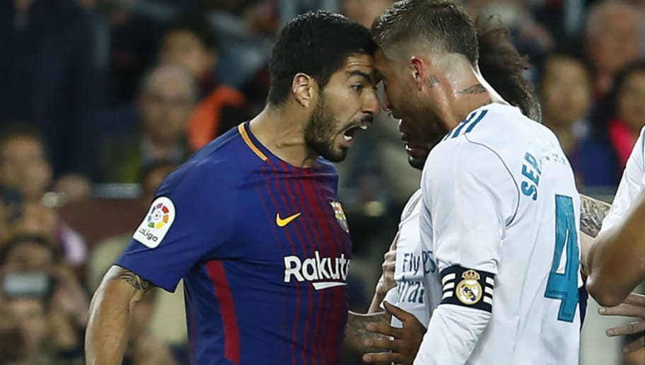Real Madrid's Spanish defender Sergio Ramos argues with Barcelona's Uruguayan forward Luis Suarez (L) during the Spanish league football match between FC Barcelona and Real Madrid CF at the Camp Nou stadium in Barcelona on May 6, 2018. (Photo by Pau Barrena / AFP)        (Photo credit should read PAU BARRENA/AFP/Getty Images)