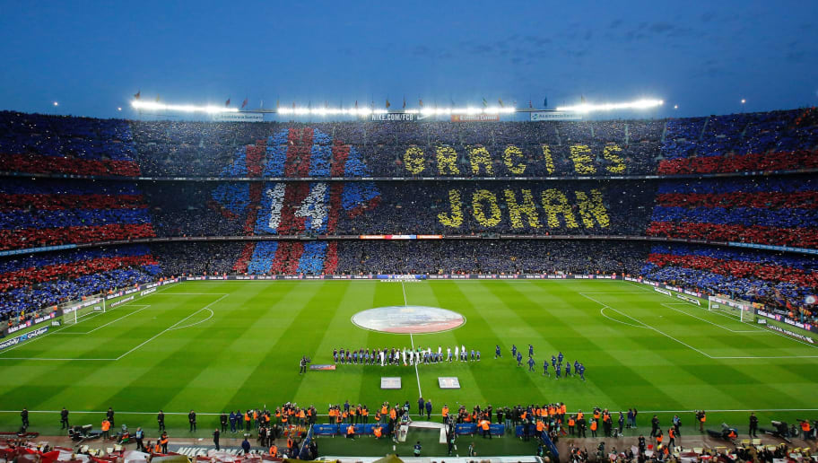 Football supporters hold-up coloured rectangular posters to form a giant mosaic reading, 'Thankyou Johan', in tribute to late Dutch football player Johan Cruyff before the Spanish league 'Clasico' football match FC Barcelona vs Real Madrid CF at the Camp Nou stadium in Barcelona on April 2, 2016. / AFP / PAU BARRENA        (Photo credit should read PAU BARRENA/AFP/Getty Images)