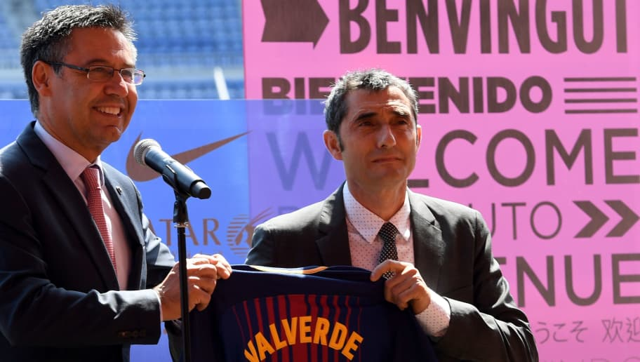Barcelona's new coach Ernesto Valverde (R) and Barcelona's president Josep Maria Bartomeu (L) hold a jersey with Valverde's name on it during his official presentation at the Camp Nou stadium in Barcelona on June 1, 2017, after signing his new contract with the Catalan club. / AFP PHOTO / LLUIS GENE        (Photo credit should read LLUIS GENE/AFP/Getty Images)