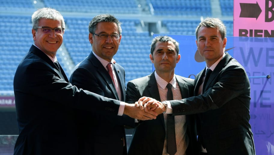 Barcelona's new coach Ernesto Valverde (2nd R) holds hands with Barcelona's president Josep Maria Bartomeu (2nd L), third vice president Jordi Mestre (L) and sports director, Robert Fernandez (R) during Valverde's official presentation at the Camp Nou stadium in Barcelona on June 1, 2017, after signing his new contract with the Catalan club. / AFP PHOTO / LLUIS GENE        (Photo credit should read LLUIS GENE/AFP/Getty Images)