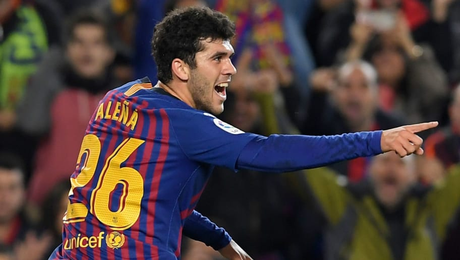 Barcelona's Spanish midfielder Carles Alena celebrates after scoring during the Spanish league football match FC Barcelona against Villarreal CF at the Camp Nou stadium in Barcelona on December 2, 2018. (Photo by LLUIS GENE / AFP)        (Photo credit should read LLUIS GENE/AFP/Getty Images)