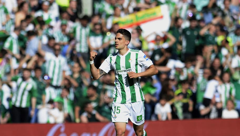 Real Betis' Spanish defender Marc Bartra celebrates after scoring a goal during the Spanish league football match between Real Betis and Sevilla at the Benito Villamarin stadium in Sevilla on May 12, 2018. (Photo by CRISTINA QUICLER / AFP)        (Photo credit should read CRISTINA QUICLER/AFP/Getty Images)