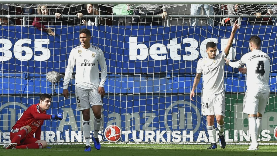 (FromL) Real Madrid's Belgian goalkeeper Thibaut Courtois, Real Madrid's French defender Raphael Varane, Real Madrid's Spanish midfielder Daniel Ceballos and Real Madrid's Spanish defender Sergio Ramos react after Eibar's Argentinian midfielder Gonzalo Escalante scored a goal during the Spanish league football match between SD Eibar and Real Madrid CF at the Ipurua stadium in Eibar on November 24, 2018. (Photo by ANDER GILLENEA / AFP)        (Photo credit should read ANDER GILLENEA/AFP/Getty Images)