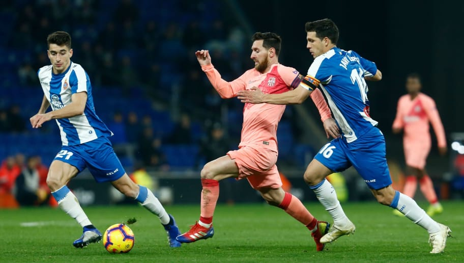 Barcelona's Argentinian forward Lionel Messi (C) vies for the ball with Espanyol's Spanish midfielder Marc Roca (L) and Espanyol's Spanish defender Javier Lopez during the Spanish league football match RCD Espanyol against FC Barcelona at the RCDE Stadium in Cornella de Llobregat on December 8, 2018. (Photo by PAU BARRENA / AFP)        (Photo credit should read PAU BARRENA/AFP/Getty Images)