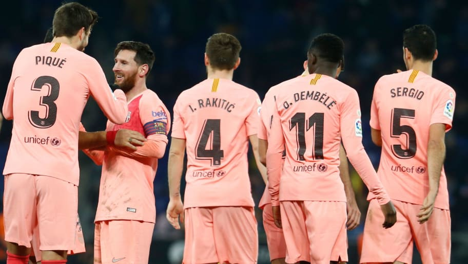 Barcelona's Argentinian forward Lionel Messi (2L) celebrates  with Barcelona's Spanish defender Gerard Pique  after scoring during the Spanish league football match RCD Espanyol against FC Barcelona at the RCDE Stadium in Cornella de Llobregat on December 8, 2018. (Photo by PAU BARRENA / AFP)        (Photo credit should read PAU BARRENA/AFP/Getty Images)