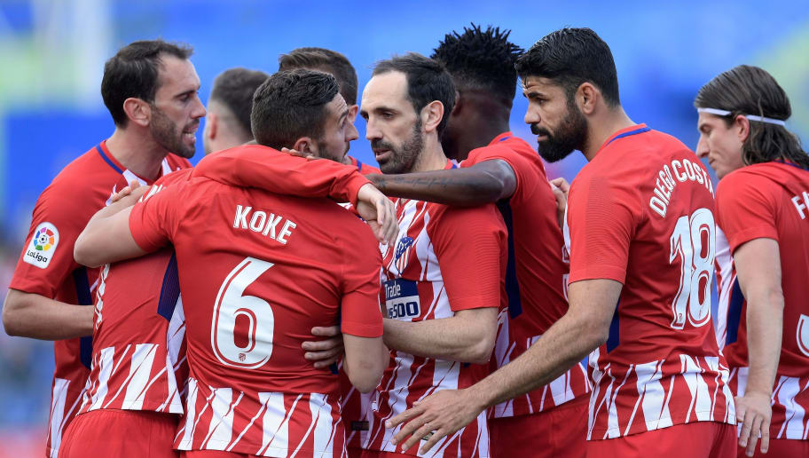 Atletico Madrid's Spanish midfield Koke (3L) celebrates with teammates after scoring a goal during the Spanish league football match between Getafe and Atletico Madrid at the Coliseum Alfonso Perez stadium in Getafe on May 12, 2018. (Photo by OSCAR DEL POZO / AFP)        (Photo credit should read OSCAR DEL POZO/AFP/Getty Images)