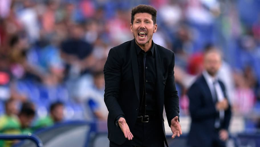 Atletico Madrid's Argentinian coach Diego Simeone gestures during the Spanish league football match between Getafe CF and Club Atletico de Madrid at the Col. Alfonso Perez stadium in Getafe on September 22, 2018. (Photo by OSCAR DEL POZO / AFP)        (Photo credit should read OSCAR DEL POZO/AFP/Getty Images)