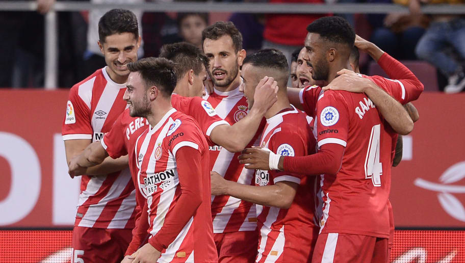 Girona's players celebrates after scoring a goal during the Spanish league football match between Girona and Club Atletico de Madrid at the Montilivi stadium in Girona on December 2, 2018. (Photo by Josep LAGO / AFP)        (Photo credit should read JOSEP LAGO/AFP/Getty Images)