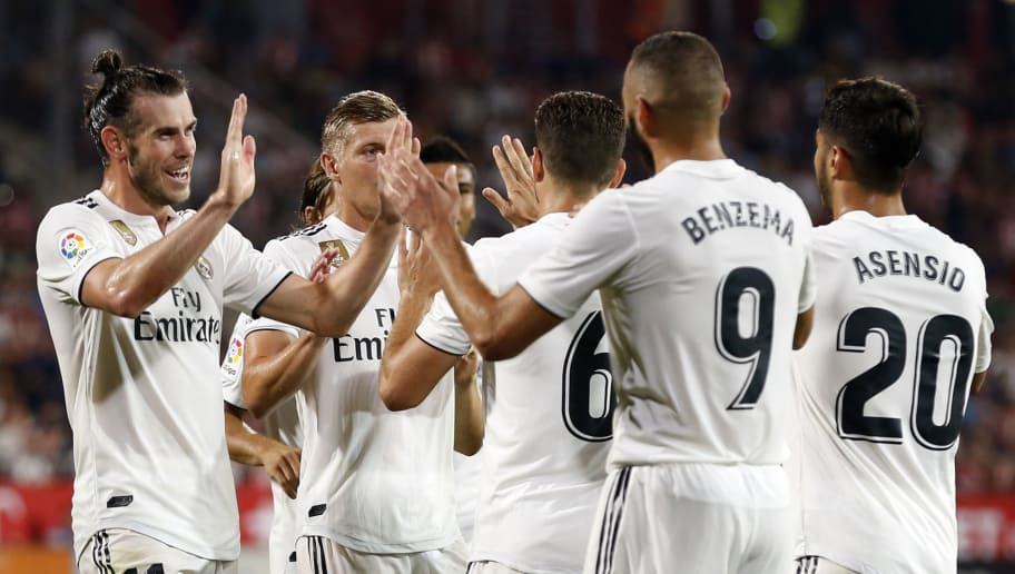 Real Madrid players celebrate their fourth goal scored by Real Madrid's French forward Karim Benzema during the Spanish league football match between Girona FC and Real Madrid CF at the Montilivi stadium in Girona on August 26, 2018. (Photo by Pau BARRENA CAPILLA / AFP)        (Photo credit should read PAU BARRENA CAPILLA/AFP/Getty Images)