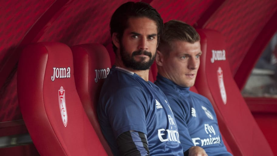 Real Madrid's midfielder Isco (L) and Real Madrid's German midfielder Toni Kroos sit on the bench before the Spanish league football match Granada FC vs Real Madrid CF at Nuevo Los Carmenes stadium in Granada on May 6, 2017. / AFP PHOTO / SERGIO CAMACHO        (Photo credit should read SERGIO CAMACHO/AFP/Getty Images)