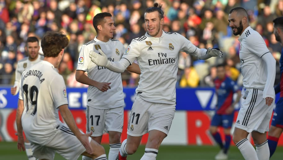Real Madrid's Welsh forward Gareth Bale (C) celebrates after scoring his team's first goal during the Spanish league football match between SD Huesca and Real Madrid CF at the El Alcoraz stadium on December 9, 2018. (Photo by ANDER GILLENEA / AFP)        (Photo credit should read ANDER GILLENEA/AFP/Getty Images)