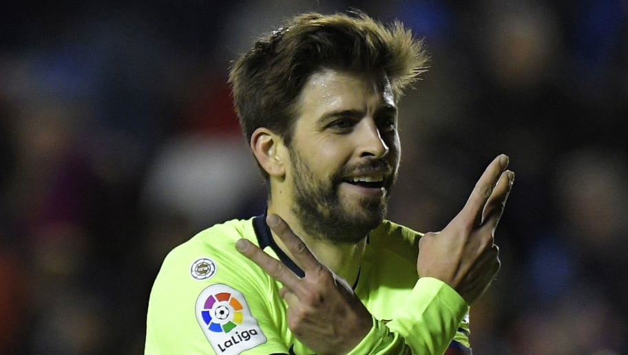 Barcelona's Spanish defender Gerard Pique celebrates after scoring a goal during the Spanish League football match between Levante and Barcelona at the Ciutat de Valencia stadium in Valencia on December 16, 2018. (Photo by JOSE JORDAN / AFP)        (Photo credit should read JOSE JORDAN/AFP/Getty Images)